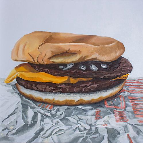 Hamburguesa con queso sobre envoltura, de Felipe Salgado