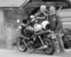 Motorcycle couple on country road with Triumph Bonneville