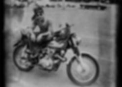 70's man on Honda 450 motorcycle in Hawaii