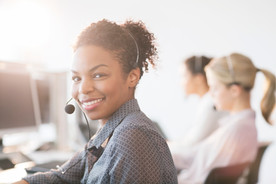 Customer service within the workplace engaged in their work, happy and meeting KPIs