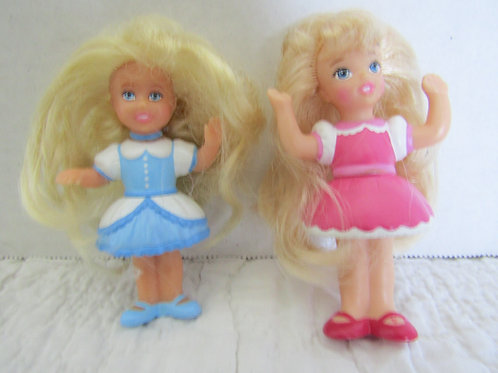 2 Small Dolls not quite vintage but not new.....