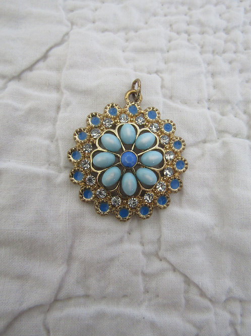 Vintage Pendant Gold tone metal with blue rhinestones and accents