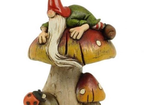 Garden gnome on mushroom