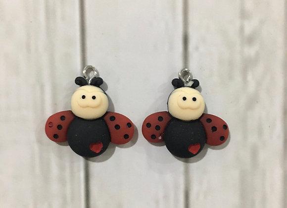 Dangle lady Beatle earrings