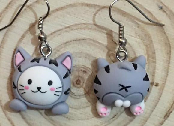 Cat dangle earrings.