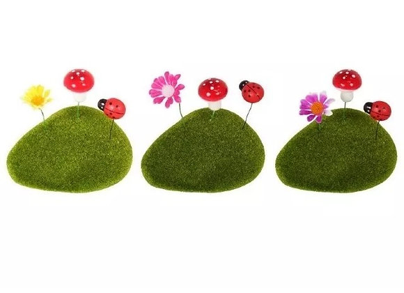 Moss rock with flowers and beetles