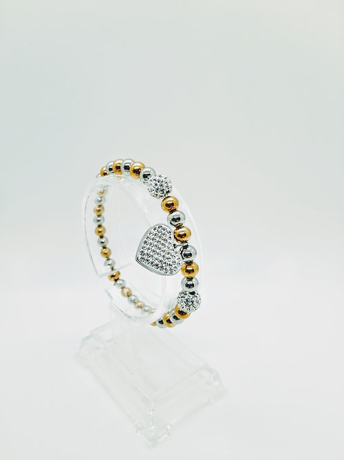 Bracciale in acciaio elastico bicolor pendente cuore con st