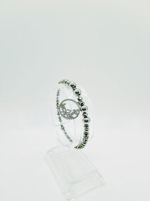 Bracciale in acciaio elastico argentato pendente tondo con farfalle e strass