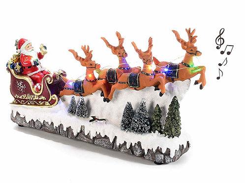 Babbo Natale su slitta in resina con luci multicolore e musica