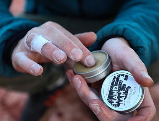 hand jam climbing balm label design