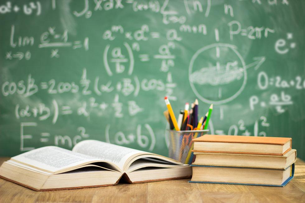 School books on desk, education concept.