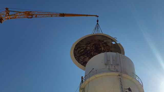 Crane Installing a Roof on a Water Tower