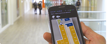 User navigating via indoor map on mobile phone