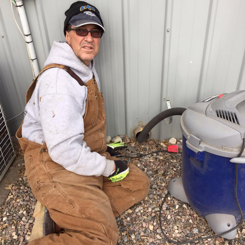 Me cleaning out a plugged solid dryer pipe. Very lucky this did not cause a fire.