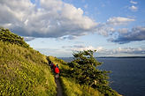 a-family-hikes-along-a-trail-while-enjoy