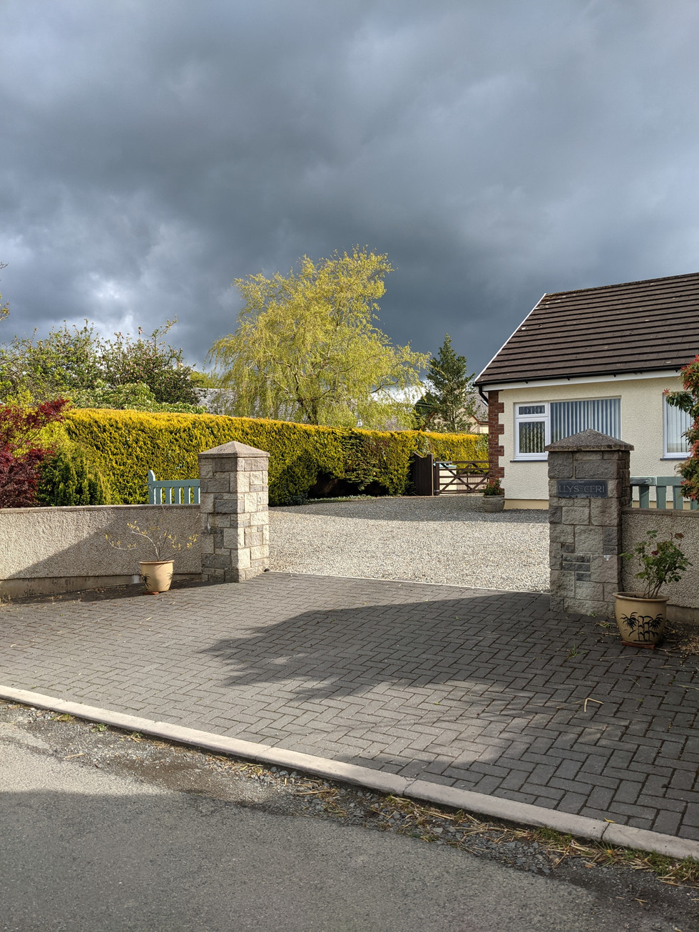 Access to private drive  and parking area next to accommodation.
