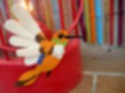 Colibri orange en papier découpé illustration