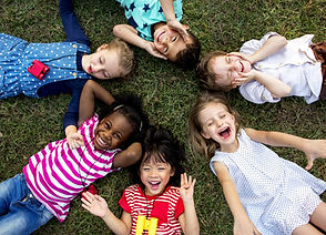 Group of kids lying on the grass