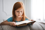 Girl in Blue T-shirt Reading a book.