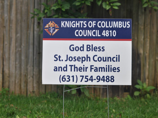KofC God Bless with phone number.JPG