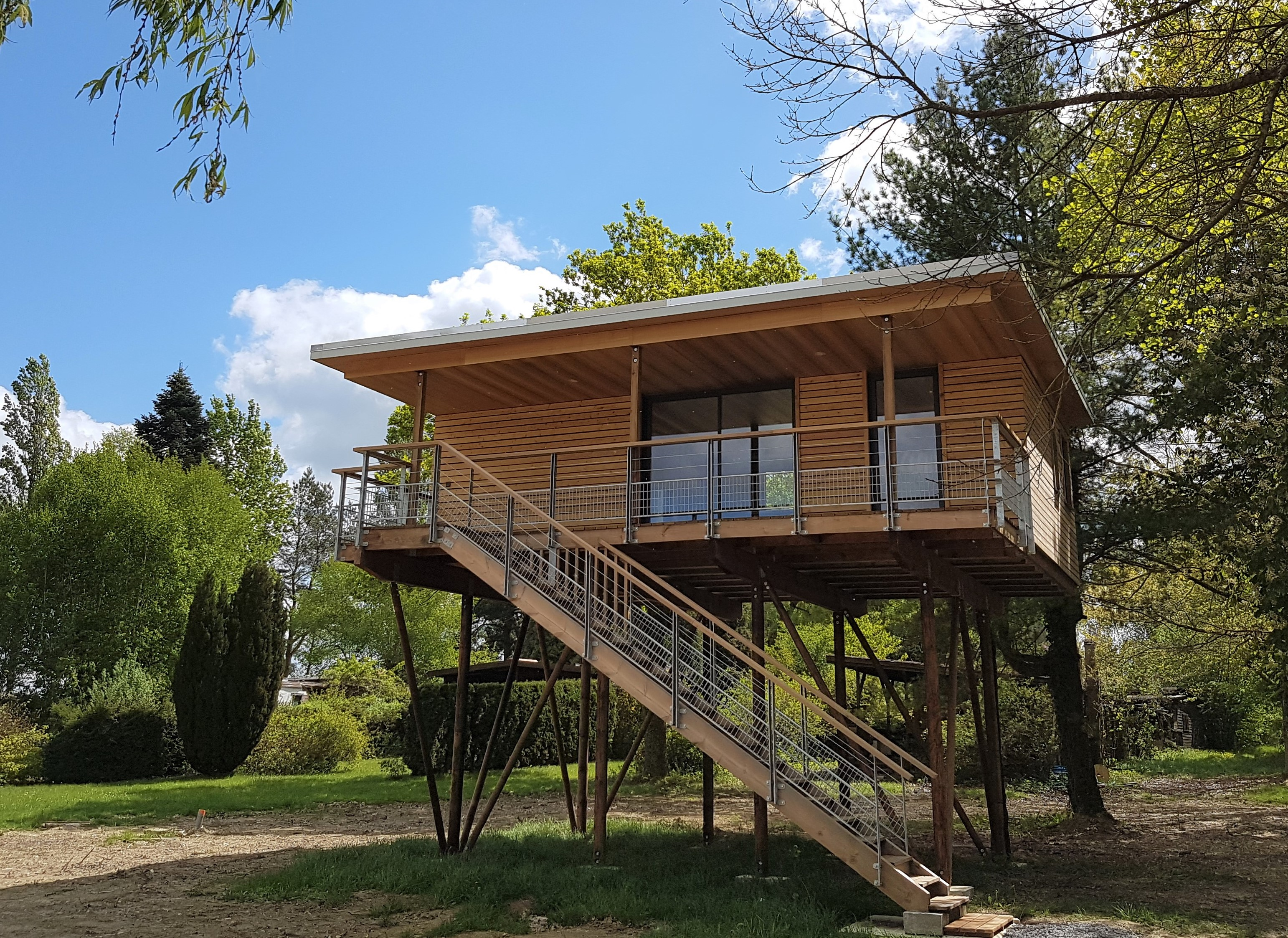 vue maison dans les arbres Langatte