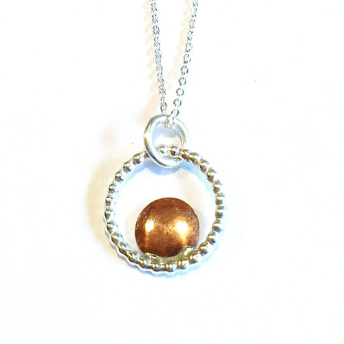 Sterling silver disc pendant