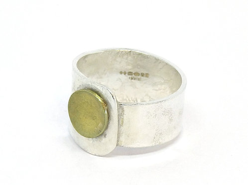 Wide band silver and brass ring