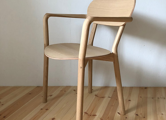 Castor arm chair