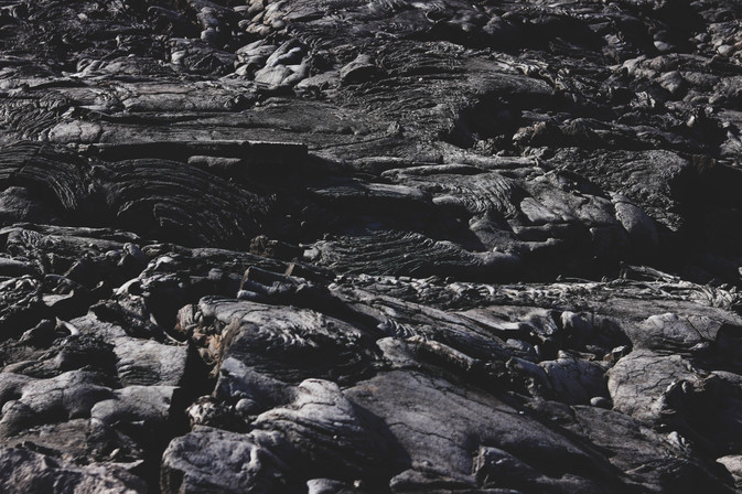 """Pahoehoe basalt forms when lava moves slowly, creating smoother wrinkles. Aa are sharp basaltic pieces formed from rapid flowing lava. Aa is pronounced """"Ah-ah"""" which is kinda the sound you make when you walk on it barefoot"""