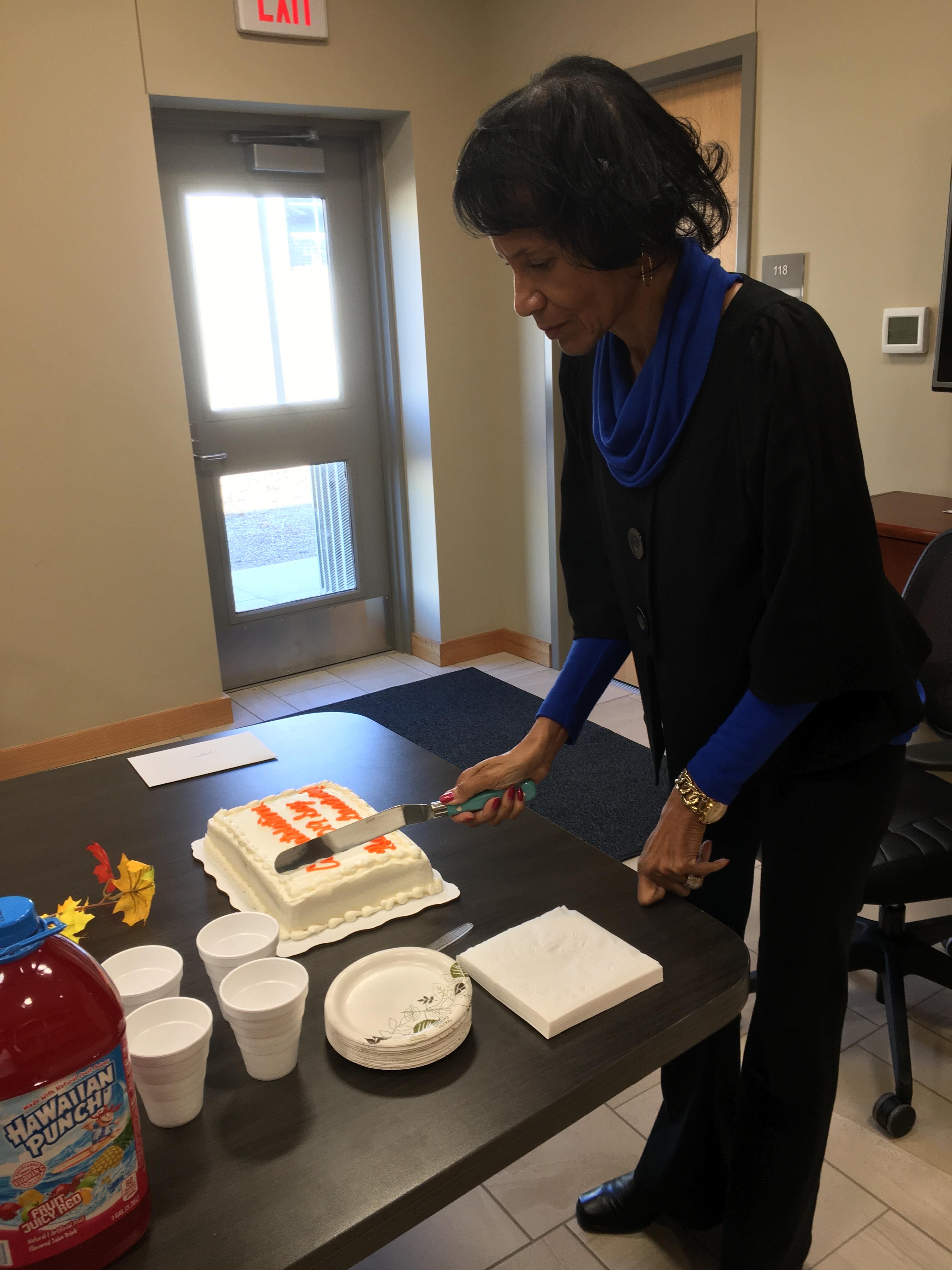 Denise slices the cake