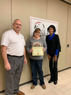Stacey Dawson accepts OSU Certificate