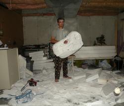 Jonny making a dinosaur family out of foam