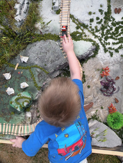 Landen playing with the diorama