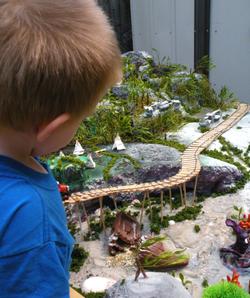 boy playing with diorama