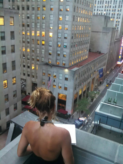 A Photo of Michelle Seay Drawing  From a NYC Rooftop  2016