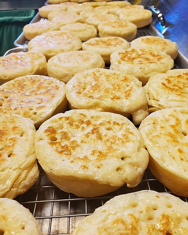 A rack of freshly baked crumpets.