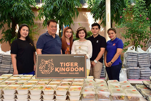 Representatives from Tiger Kingdom Phuket donate food to Vachira Hospital