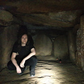 Bjørn inside a megalithic tomb on a hike at Møn, Denmark June 2020