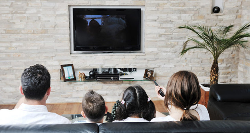family_watching_tv-AdobeStock2-730x390.j