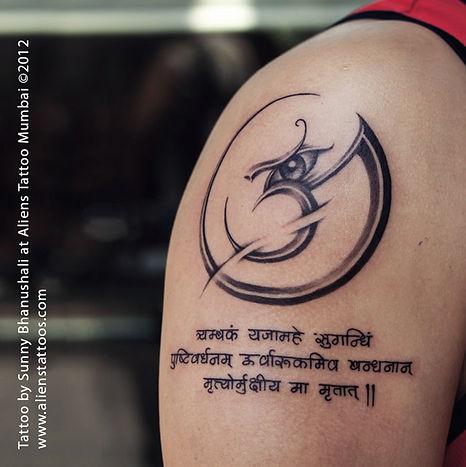 Aum with mantra tattoo