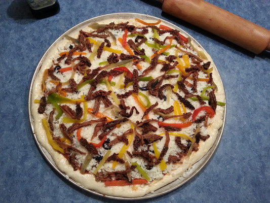 Wild morel mushrooms are amazing on pizza. Fresh garden sweet bell peppers adorn the top of this beauty.