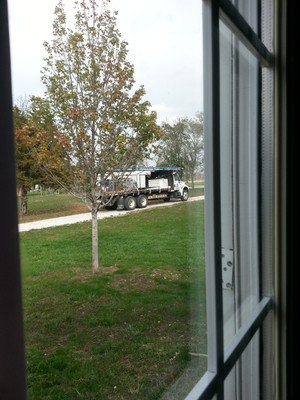 The roofers arrived early in the morning.
