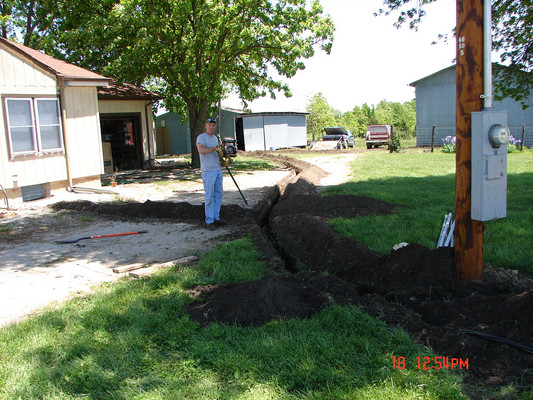 When the weather finally dried, we went to work outdoors. Ronnie buried all of the overhead electrical lines to the house, and all of the outbuildings, cleaning up the skyline appearance.