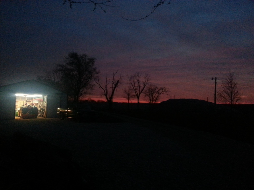 Early morning in the barn watching the sunrise and listening to the animals waking up.
