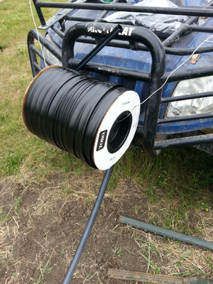 I had to come up with an innovative way to install drip tape with the UTV.