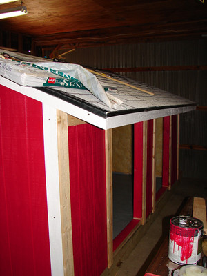 Building the pig hut inside the barn.