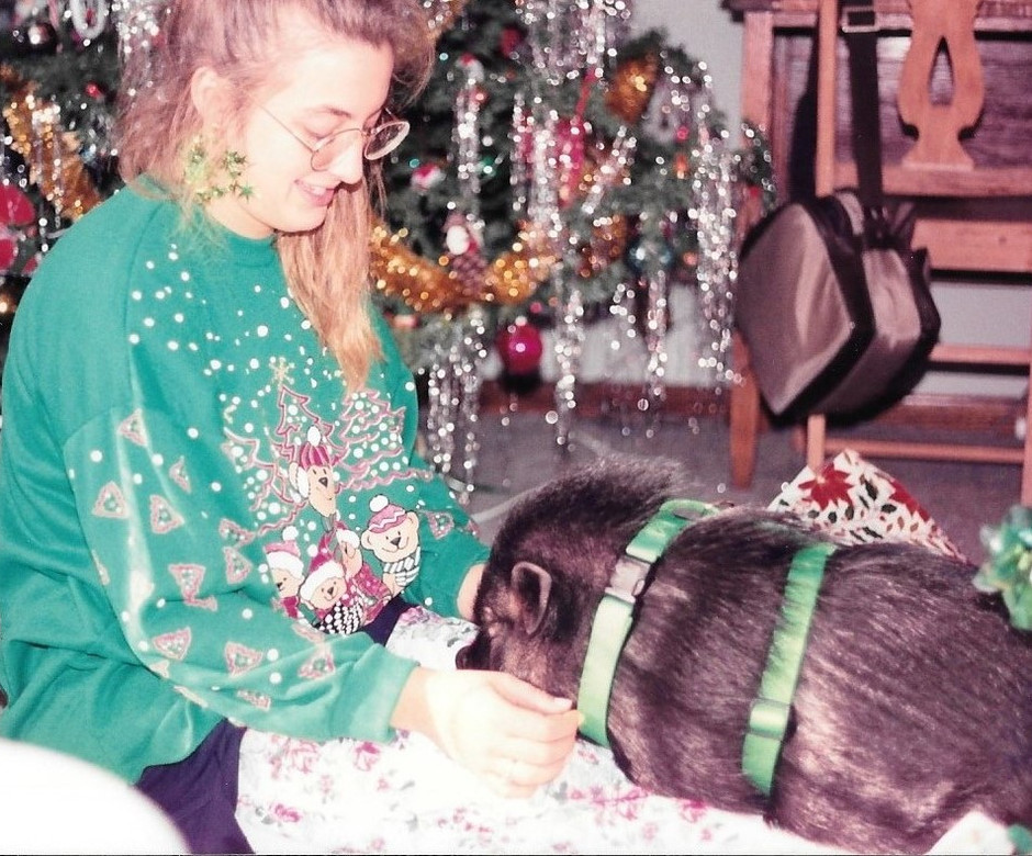 My sister and my pig. Pea Soup was rooting through the Christmas wrapping papers looking for snacks.