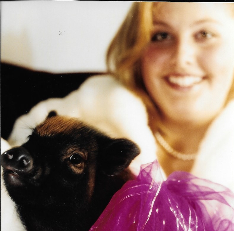 I posed for my Sweet Sixteen picture with my little piglet.