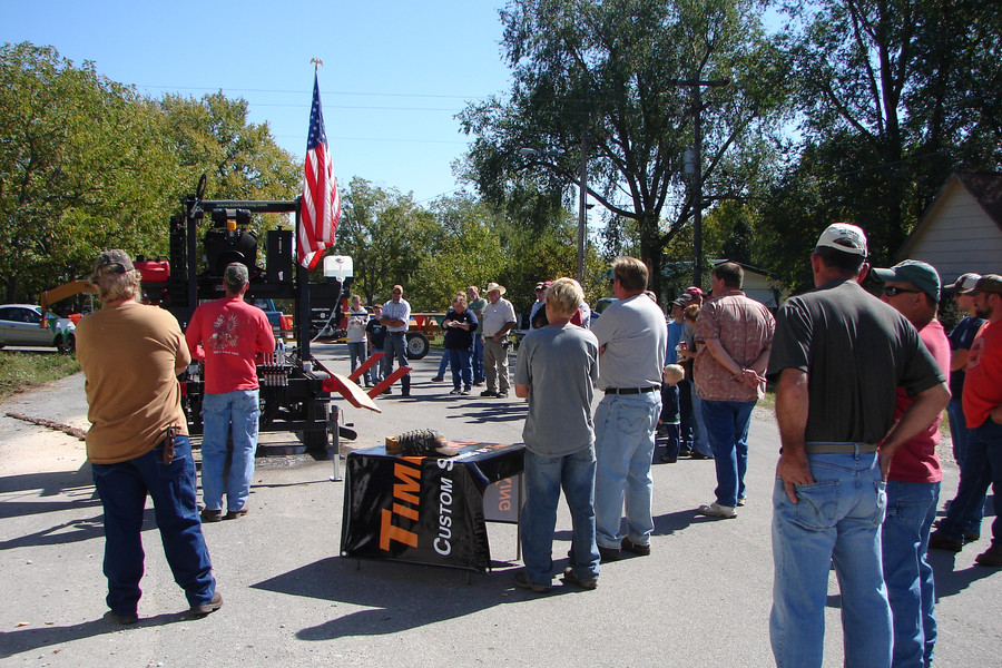 This photo is of Ronnie at the town expo putting on a modern-day sawmill demo.