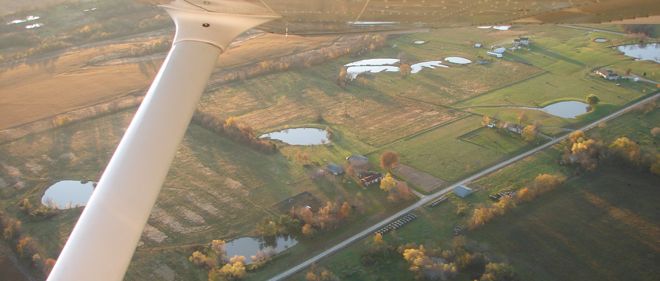 An aerial photo of our farm in the days before drones. We were so ready to move. I wanted to get living again.